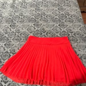 Express pleated mini skirt in neon coral